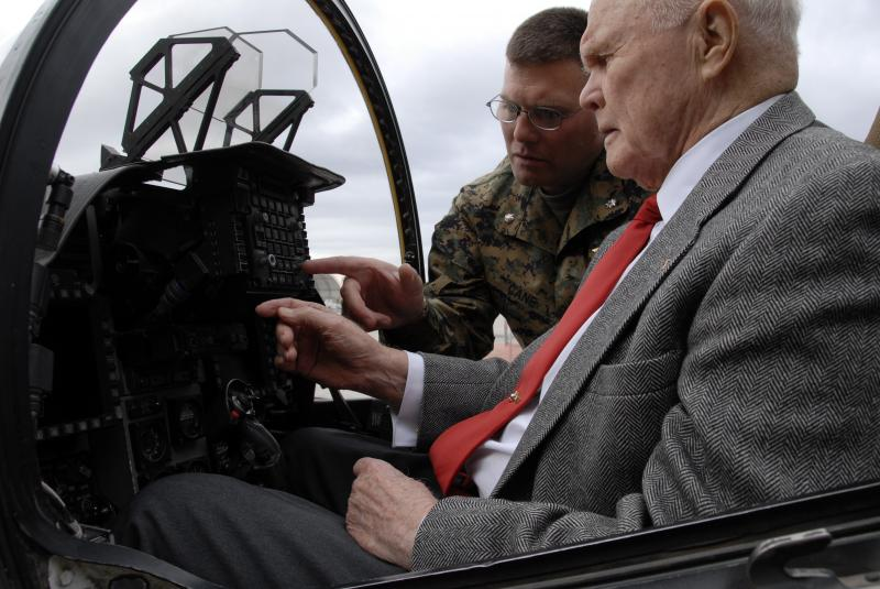 LtCol. John Cane familiarizes Sen. John Glenn with the AV-8B II+ Harrier cockpit